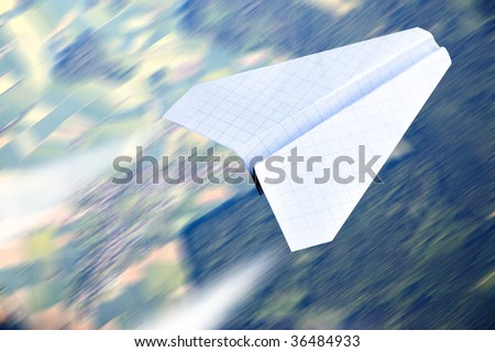 Aerial view in motion blur and paper plane flying - stock photo