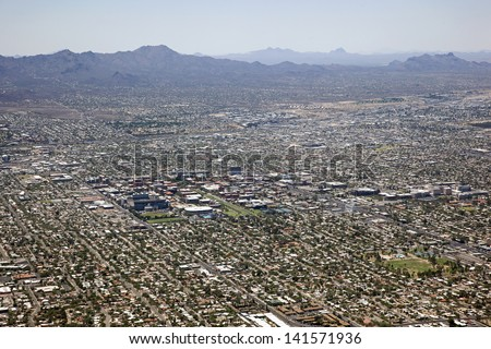 Aerial view looking west at the Tucson Mountains, University of Arizona, Interstate 10 and the city of Tucson skyline - stock photo