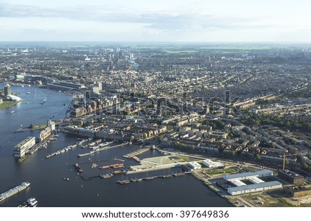Aerial view of a Amsterdam with the SPAARNADAMMERBUURT and ZEEHELDENBUURT. In the front of the picture the river IJ.  - stock photo