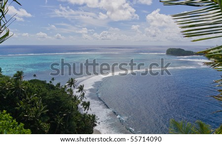 aerial view of a beautiful bay with crystal clear blue water and sky