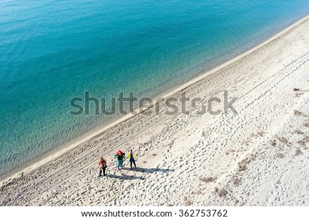 Aerial view of a beautiful beach in Chalkidi, Greece with people  - stock photo