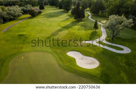 Aerial view of a beautiful green golf course. - stock photo