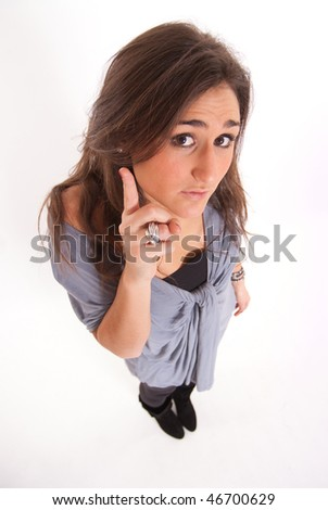Aerial view of a brunette raising her finger to ask a question - stock photo