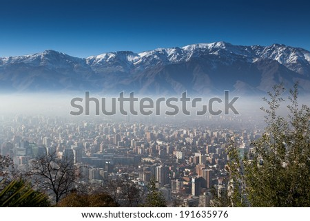 Aerial view of a city with mountain in the background, Andes, Santiago, Chile - stock photo