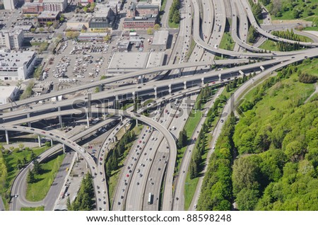 Aerial view of a complex interchange during rush hour - stock photo