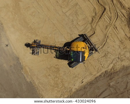 Aerial view of a digger  tracked excavators at work on a construction site - stock photo