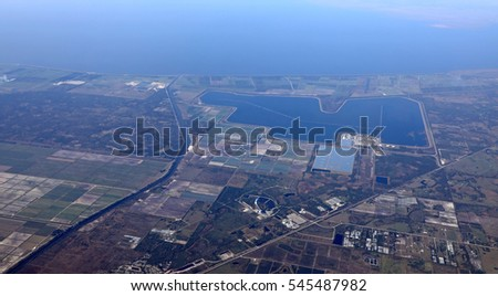 Aerial view of a gas-fired power plant with cooling pond on the shores of Lake Okeechobee in Southern Florida, near Port Mayaca.