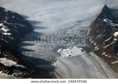 Aerial view of a glacier in Greenland - stock photo