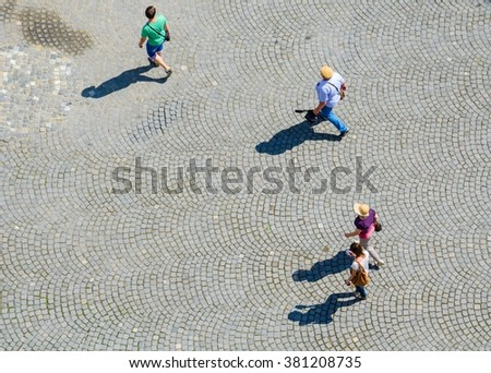 Aerial View Of A Group People Passing Through Courtyard Next To The Lutheran Cathedral