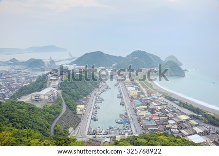Aerial view of a harbor in northern Taiwan on a foggy morning ~ Beautiful coastline in northern Taiwan - stock photo