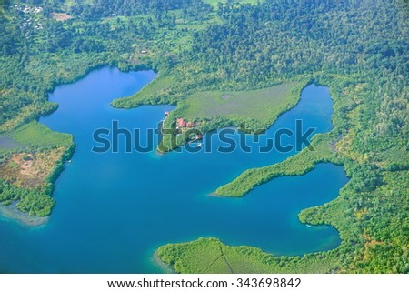 Aerial view of a lagoon with a small resort in construction in the archipelago of Bocas del Toro, Cristobal island, Panama, Central America - stock photo