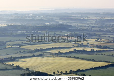 Aerial view of a landscape at sunrise - stock photo