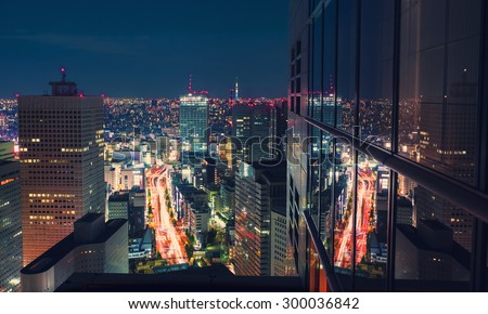 Aerial view of a massive highway intersection at night in Shinjuku, Tokyo, Japan from a skyscraper - stock photo