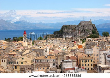 Aerial view of a mediterranean town with a fortress and a steeple on the background, Kerkyra, Greece. Unesco World Heritage Site - stock photo