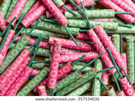 Aerial view of a messy pile of different types of firecrackers. - stock photo