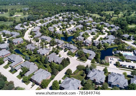 Aerial view of a neighborhood housing complex with ponds in the Chicago suburban city of Northbrook, IL in summer. USA.