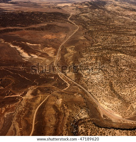 Aerial view of a of rural, desert landscape with roads running through it. Square shot. - stock photo