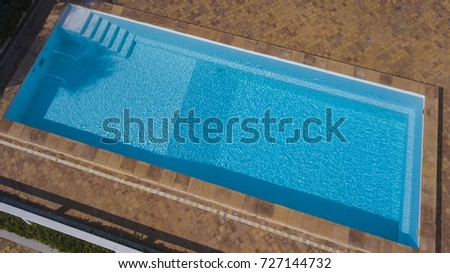 Aerial View Of A Rectangular Swimming Pool Belonging To A Large Villa. The  Water Is