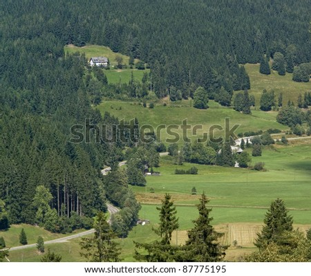 aerial view of a sunny illuminated scenery in the Black Forest (Southern Germany) at summer time - stock photo