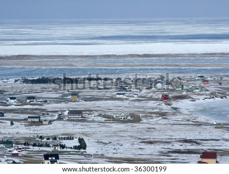 Aerial view of a town in the Canadian Arctic - stock photo