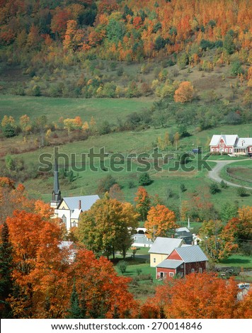 Aerial view of a town with church steeple in autumn, Vermont  - stock photo
