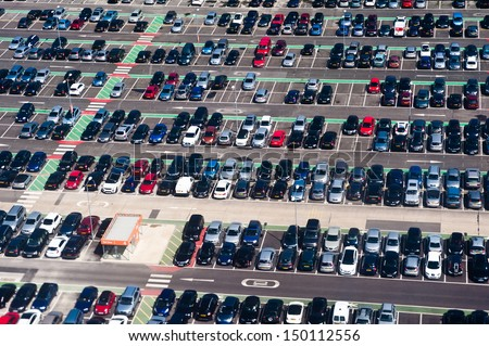 Aerial view of airport car crowded parking lot - stock photo