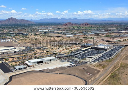 Aerial view of airport parking and transportation venues - stock photo