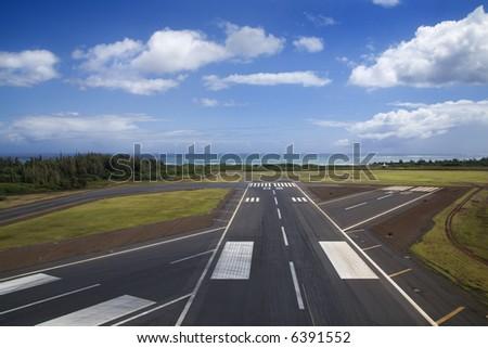 Aerial view of airport runway on coastline of Maui, Hawaii. - stock photo