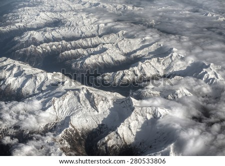 Aerial view of Alps in Winter - stock photo