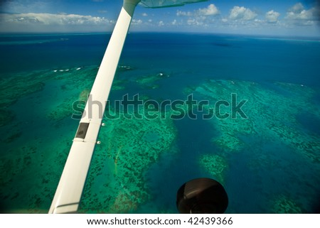Aerial view of Arlington Reef at Great Barrier Reef Marine Park - stock photo