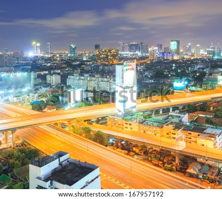 aerial view of Bangkok Highway to Downtown business area at night - stock photo