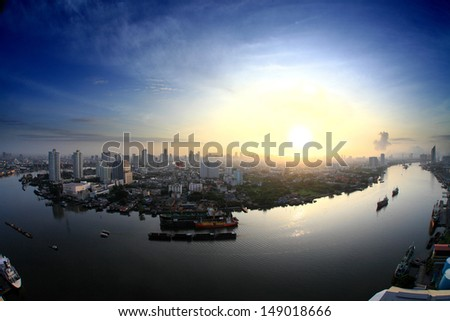 Aerial view of Bangkok Skyline along Chaophraya River at dusk with star trail  - stock photo