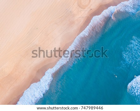 Aerial view of beach with turquoise water.