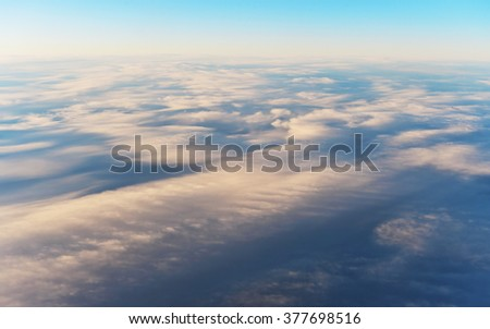 Aerial View of Beautiful Cirrus Clouds at Sunset - stock photo