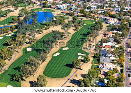 Aerial view of beautiful, mature golf course in the desert southwest - stock photo