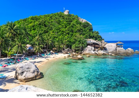 Aerial view of beautiful sea on tropical island with crystal clear water - stock photo