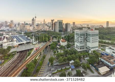 Aerial view of beautiful sunrise at Kuala Lumpur city centre - stock photo