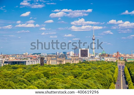 Aerial view of Berlin skyline panorama with Grosser Tiergarten public park on a sunny day with blue sky and clouds in summer seen from Berlin Victory Column (Berliner Siegessaeule), Germany - stock photo