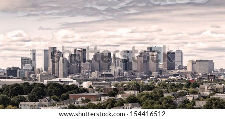 Aerial view of Boston in Massachusetts, USA. Panoramic photo showing its Financial district on the background and suburbs on the foreground. - stock photo