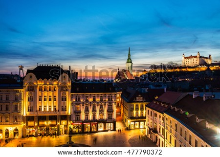 Aerial view of Bratislava, Slovakia at night. Famous castle and illuminated historical buildings with bars, cafes, restaurants and shops