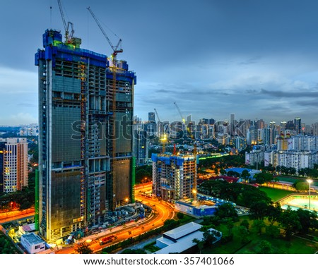 Aerial view of building construction site near the railroad track at Redhill neighborhood in Singapore at blue hour. Urban high rise construction concept - stock photo