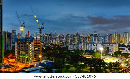 Aerial view of building construction site near the railroad track at Redhill neighborhood in Singapore at blue hour. Urban high rise construction concept. Panoramic style - stock photo