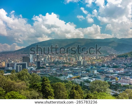 Aerial view of buildings and mountains from Nutibara hill in Medellin, one of the most important cities of Colombia, in South America - stock photo