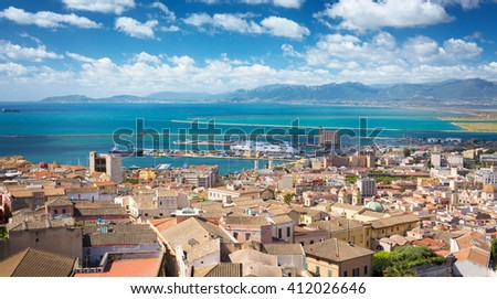 Aerial view of Cagliari with the harbor in distance - stock photo