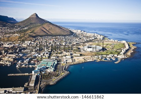 Aerial view of Cape Town with V&A Waterfront, Cape Town Stadium and Lion's Head - stock photo