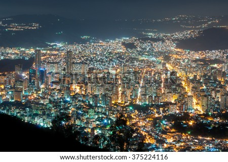 Aerial view of Caracas, at night, from a lookout in Avila mountain, showing the central part of the city, with the twin towers of Central Park.