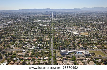 Aerial view of Central Avenue in Phoenix, Arizona looking south towards downtown and South Mountain - stock photo