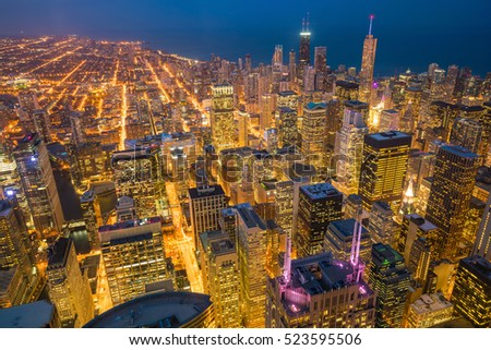 Aerial view of Chicago downtown at sunset from high above.