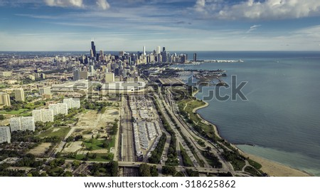 Aerial view of Chicago Downtown with railroad track and semi trailers - high angle - stock photo