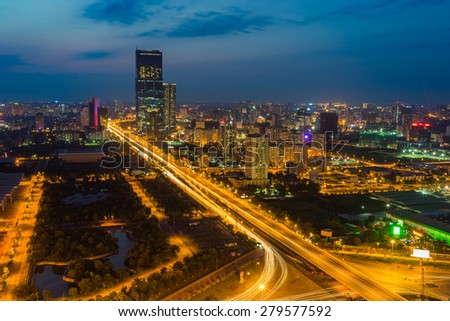Aerial view of city at sunset. Hanoi cityscape at intersection Thang Long boulevard - Pham Hung street - Tran Duy Hung street